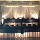 This is one of our most elegant of all of our backdrops. Beautiful sheer voile panels with the front panels drawn back. Any style bows or flowers can be added. Use uplights or string lights